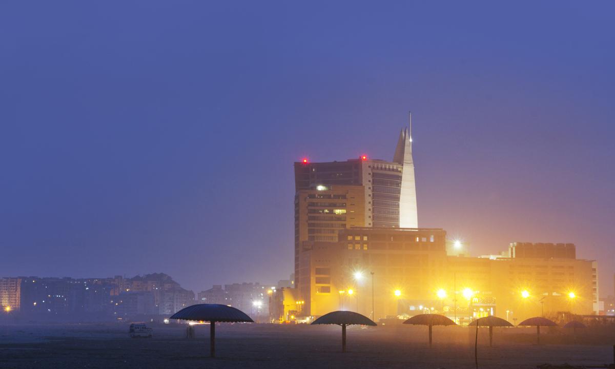 Dolmen City Mall and the empty beach - Sea view Karachi. - Photo by Aliraza Khatri