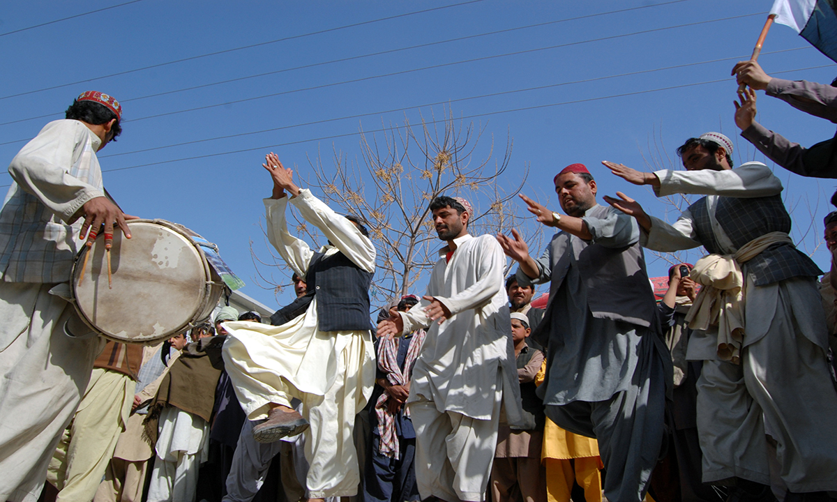 Chaman tribesmen perform their traditional dance.