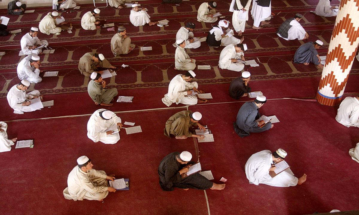 Students at a seminary give exams.
