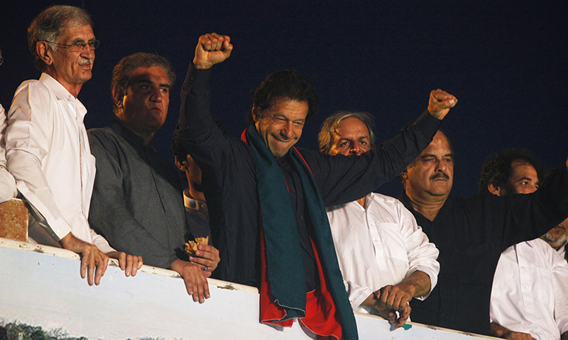 Imran Khan, chairman of the Pakistan Tehreek-e-Insaf (PTI) political party, gestures to his supporters during a Freedom March to the parliament house in Islamabad August 19, 2014 — Photo Reuters