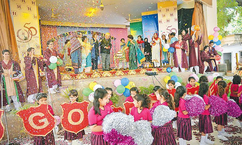 STUDENTS and teachers clap and cheer as Habib Education Trust managing trustee Muslim Habib and school principal Nargis Alvi cut the cake to celebrate 50 years of founding of Habib Girls School.—White Star