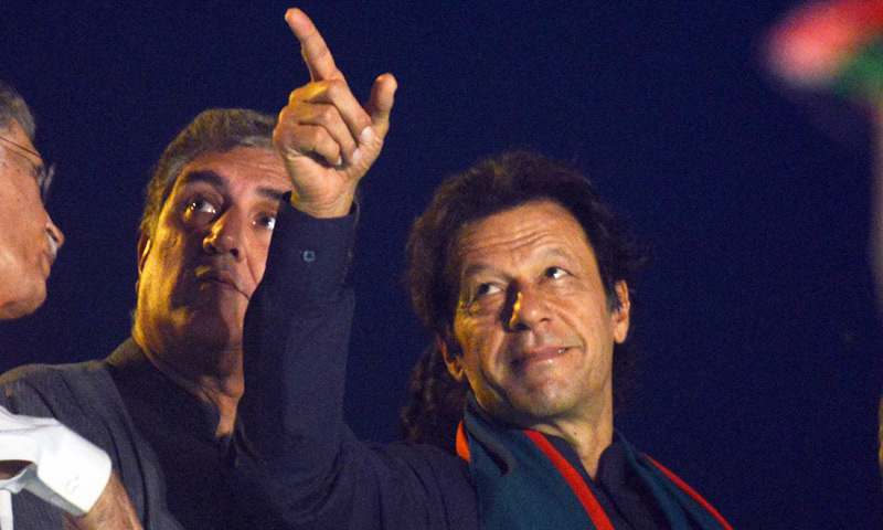 Pakistani opposition politician Imran Khan gestures during a protest march - AFP
