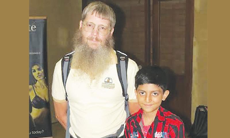 Scrabble prodigy Hasham Hadi seen with world champion Nigel Richards.