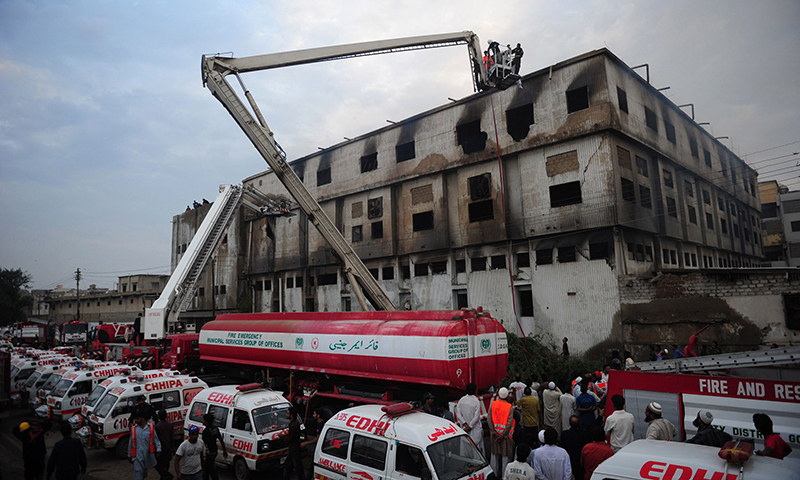 Firefighters and medical personnel take part of rescue operation in the Baldia Town garment factory in Karachi. — Photo by AFP