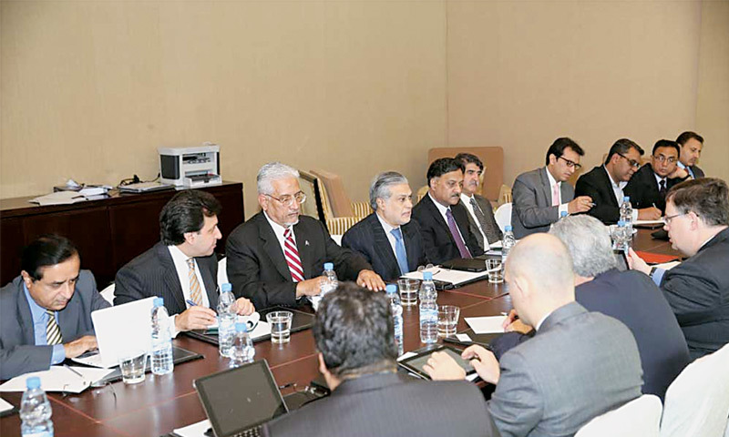 Federal Finance Minister Ishaq Dar holding a meeting with the IMF delegation in Dubai recently.