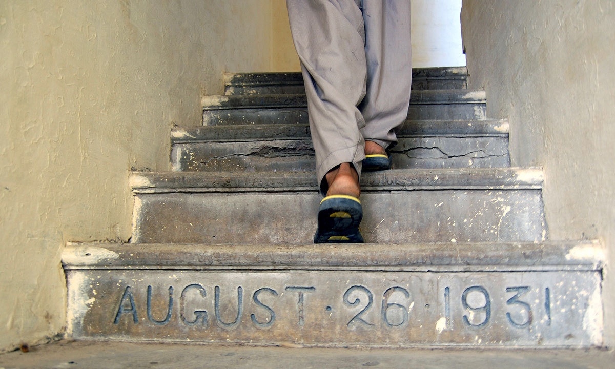 A man walks up the stairs to the Sri Sanatan Dharam Sabha. -Photo by Matiullah Achakzai