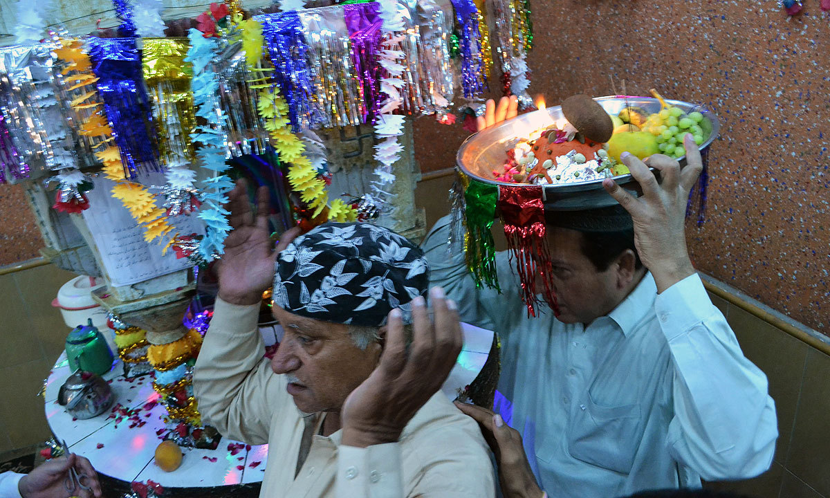 Devotees offer prayers during the Janmashtami festival. -Photo by Matiullah Achakzai