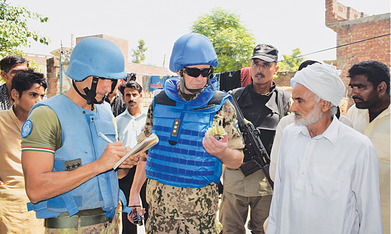 SIALKOT: United Nations peace-keeping mission's observers talk to a villager during a visit to the villages near the Indian border on Tuesday.—INP