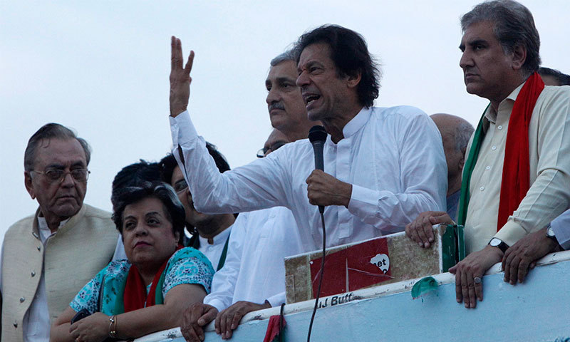 Pakistan Tehreek-i-Insaf (PTI) chairman Imran Khan speaks to protestors in Islamabad's D-Chowk.—Reuters/File Photo
