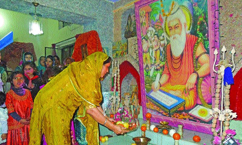 A woman prays during a religious festival at Valmiki Mandir. — File photo