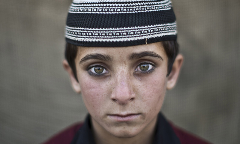 Afghan refugee boy, Hayat Khan, 8, poses for a picture. About 50,000 children are born to refugees every year..— AP file photo