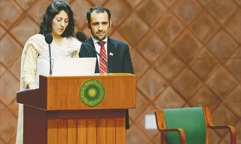 Samina Baig delivers her written speech as her brother Mirza Ali looks on.—White Star