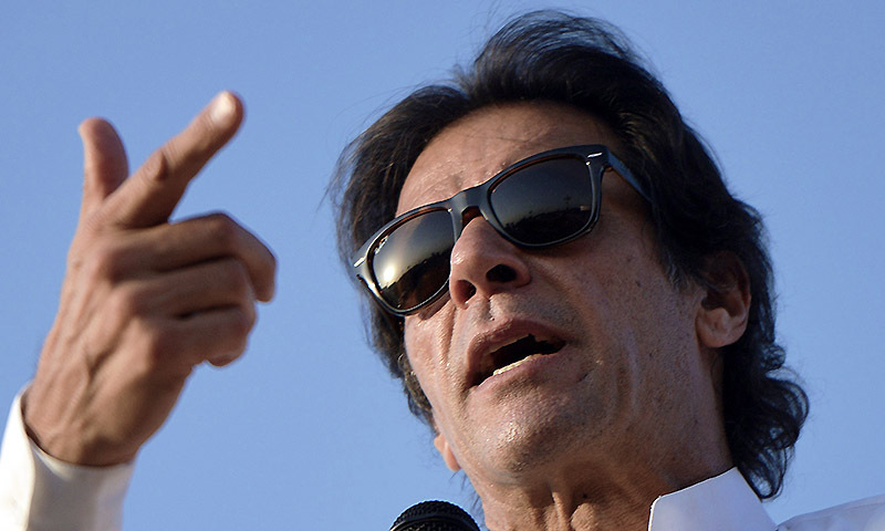 Imran Khan addresses supporters during an anti-government protest in front of the Parliament in Islamabad on August 27, 2014. — Photo by AFP