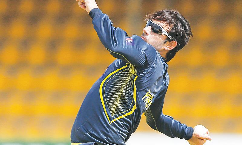 Saeed Ajmal bowls.—Reuters