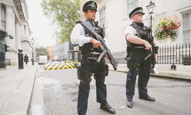 LONDON: Police personnel stand guard at Downing Street on Friday.—AFP