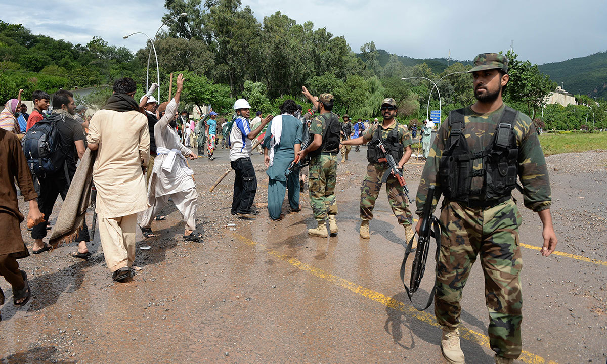 Army soldiers disperse protestors after clashes with anti-government demonstrators and police near the prime minister's residence in Islamabad on September 1, 2014. — AFP