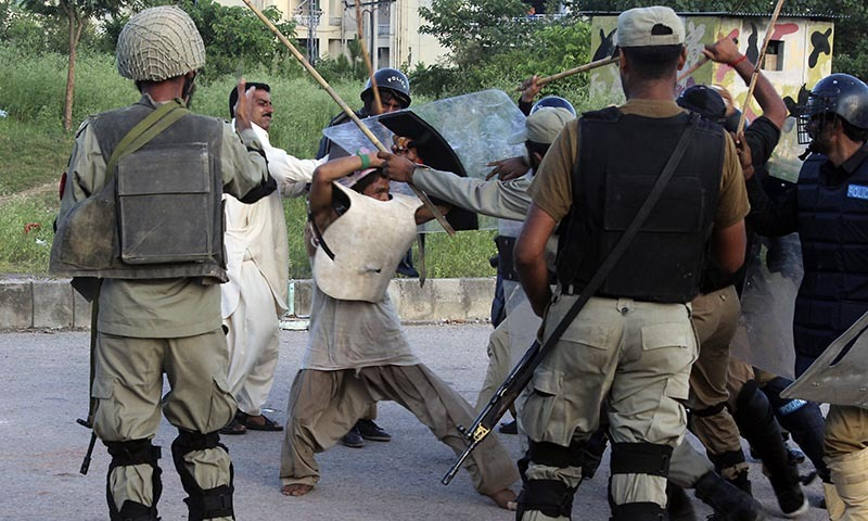 Police beat a protester during clashes in Islamabad, Pakistan, Monday, Sept. 1, 2014. — Photo by AP