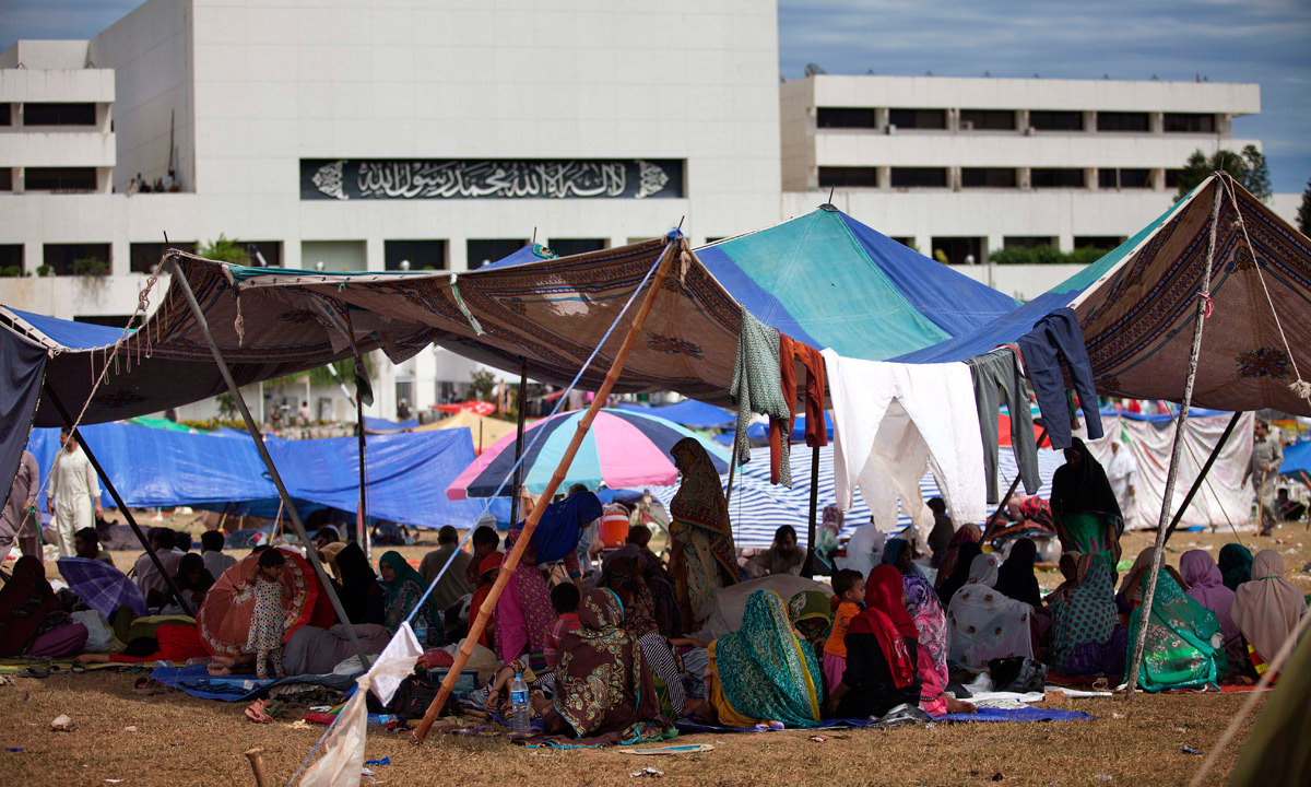 Supporters of Tahirul Qadri camp in the vicinity of the parliament building in Islamabad. - Photo by AP