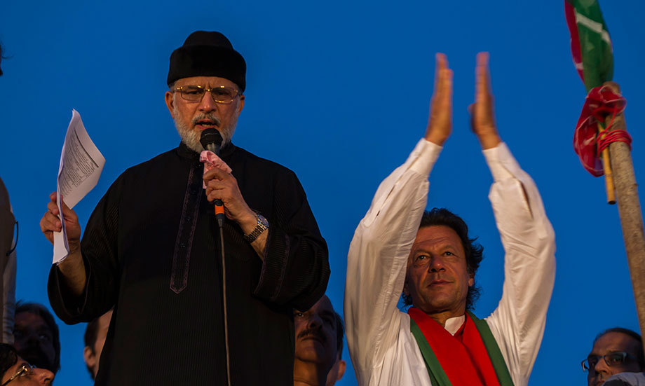 Tahirul Qadri addresses supporters while flanked by Imran Khan in Islamabad September 2, 2014. – Reuters Photo