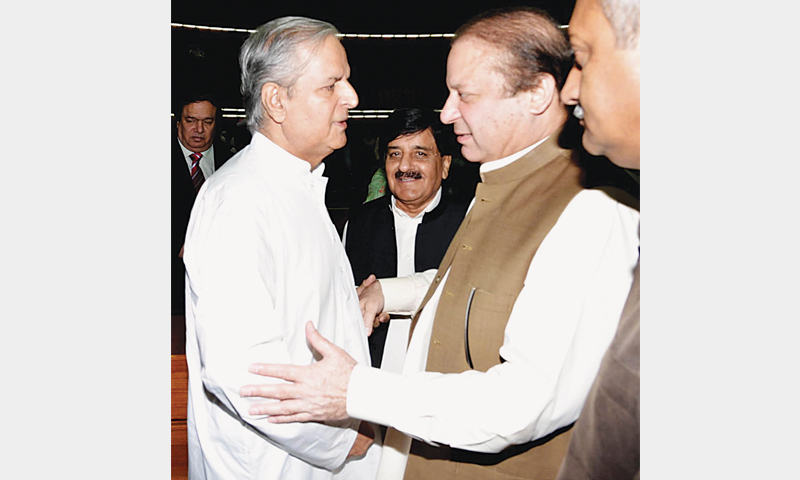 ISLAMABAD: Prime Minister Nawaz Sharif walks up to Javed Hashmi to shake hands with him after the latter's speech in parliament here on Tuesday.—Online