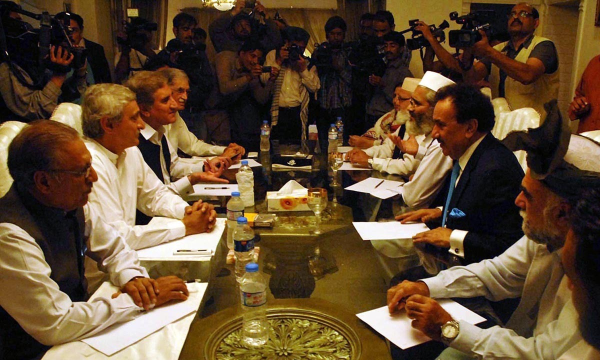 Dialogue committees of PTI and government sitting during meeting at the residence of Senator Rehman Malik.— Photo by Online