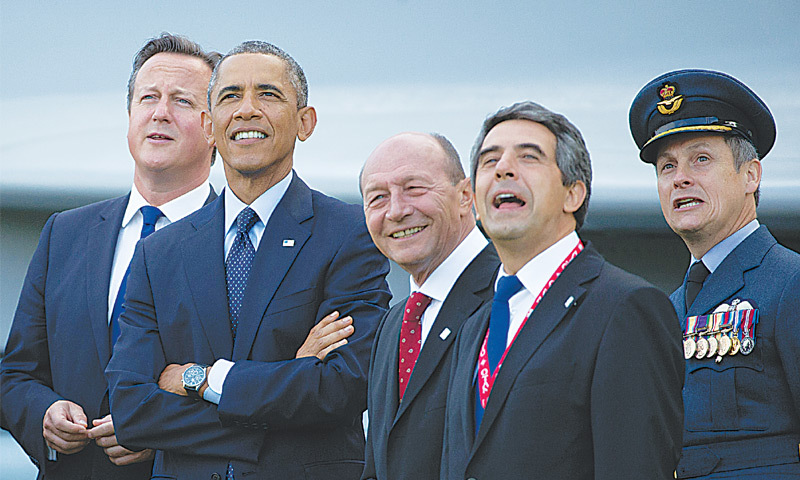 BRITISH Prime Minister David Cameron, US President Barack Obama, Romanian President Traian Basescu, Bulgarian President Rosen Plevneliev and British RAF Group Captain David Bentley watch a fly-past on the second day of Nato summit in Newport, Wales, on Friday.—AP