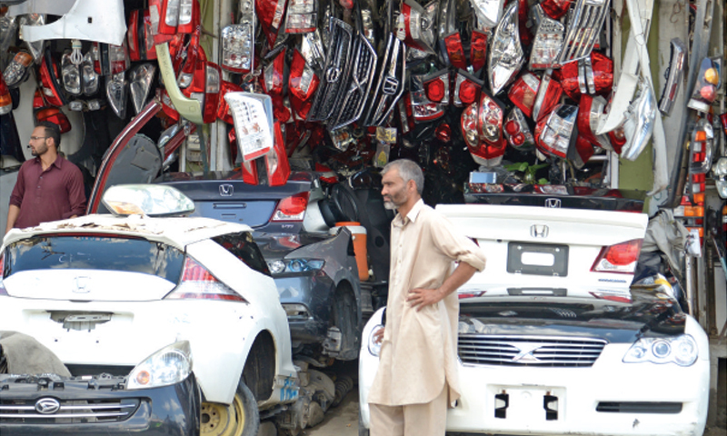 Shops at Sultan Ka Khoo selling car body parts and second-hand engines. — Photos by Khurram Amin