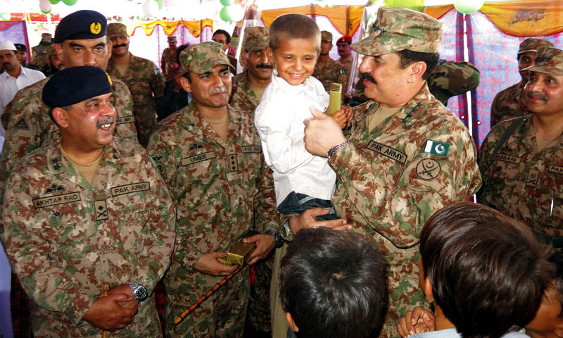 BANNU: Army chief Gen Raheel Sharif talks to a displaced child during a visit here on Satruday.—Online