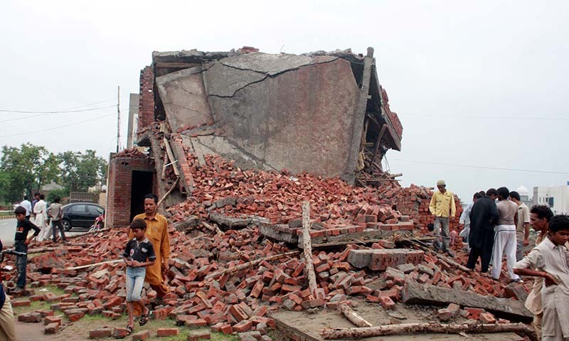 The roof of a house collapses due to heavy downpours in the Johar Town area of Lahore - PPI