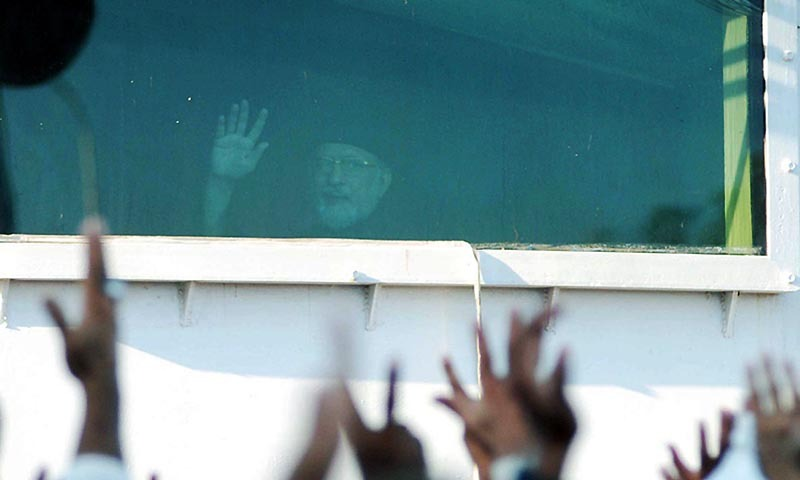 Chief of Pakistan Awami Tehreek  Dr Tahirul Qadri waving toward the party workers in Islamabad.— Photo by Online