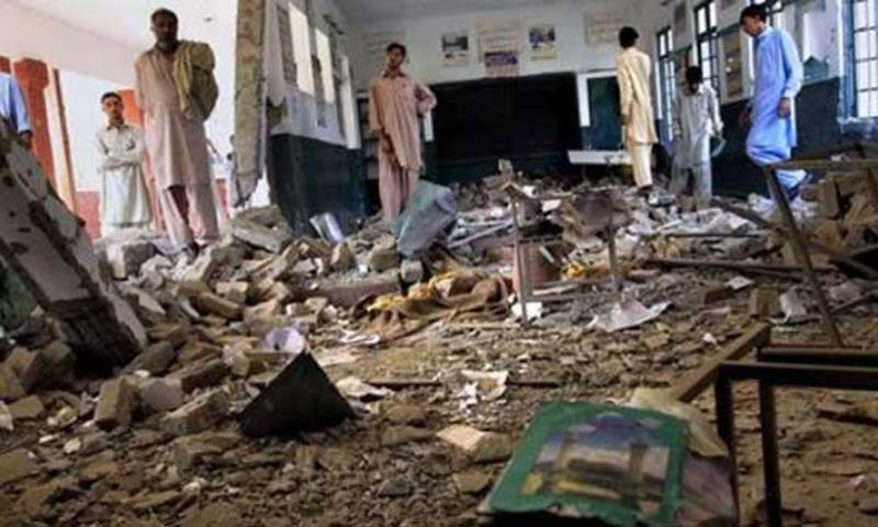 Local residents look at the damaged classroom of a girls school, wrecked by Taliban militants on the outskirt of Peshawar, Pakistan on Tuesday, Sept. 22, 2009.    — File photo by AP