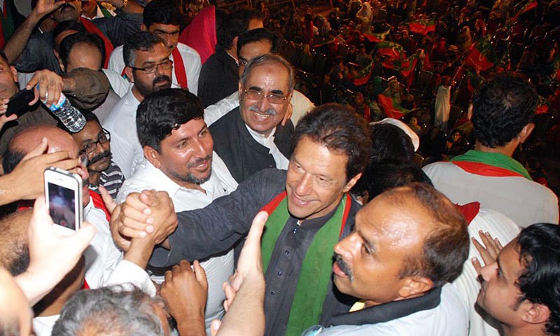 Pakistan Tehreek-i-Insaf (PTI) Chairman Imran Khan meets with his supporters at D-Chowk sit-in in Islamabad on Wednesday. – Photo by Online