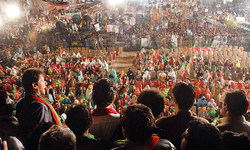 PTI Chairman Imran Khan speaks to marchers in Islamabad on Wednesday night. – Photo by Online