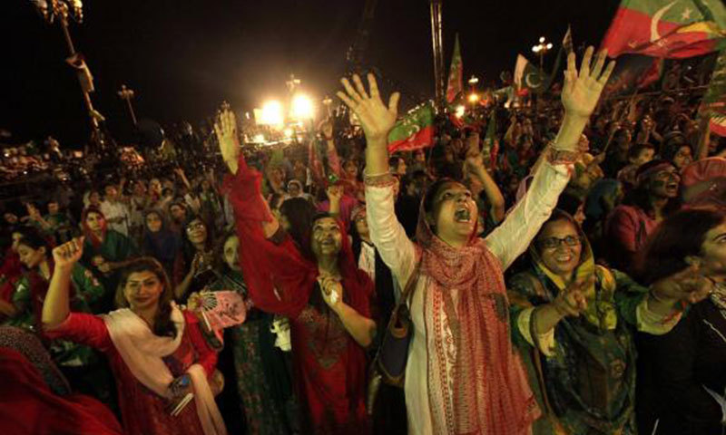 Supporters of Pakistan Tehreek-i-Insaf cheer joyfully at the Azaadi march in Islamabad. - Reuters