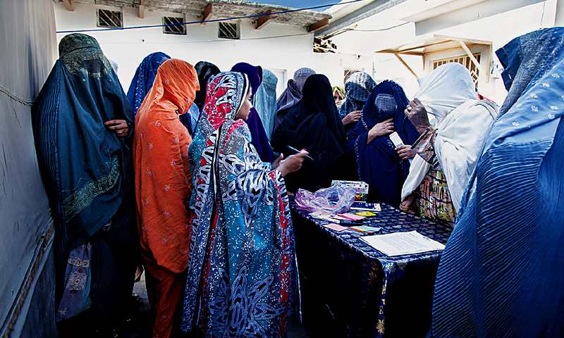 Women rushing to collect  a token number for the antenatal clinic