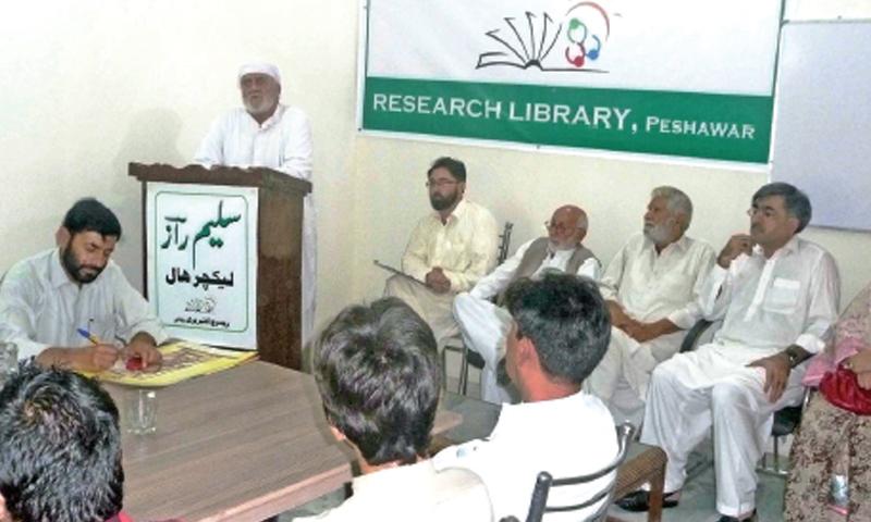 Renowned writer Saadullah Jan Barq addresses a literary gathering in Peshawar. — Dawn
