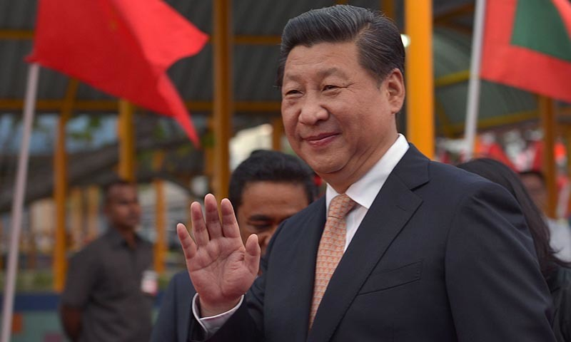 Chinese President Xi Jinping waves upon his arrival at the Ibrahim Nasir International Airport in Hulhule on  September 14, 2014.— Photo by AFP