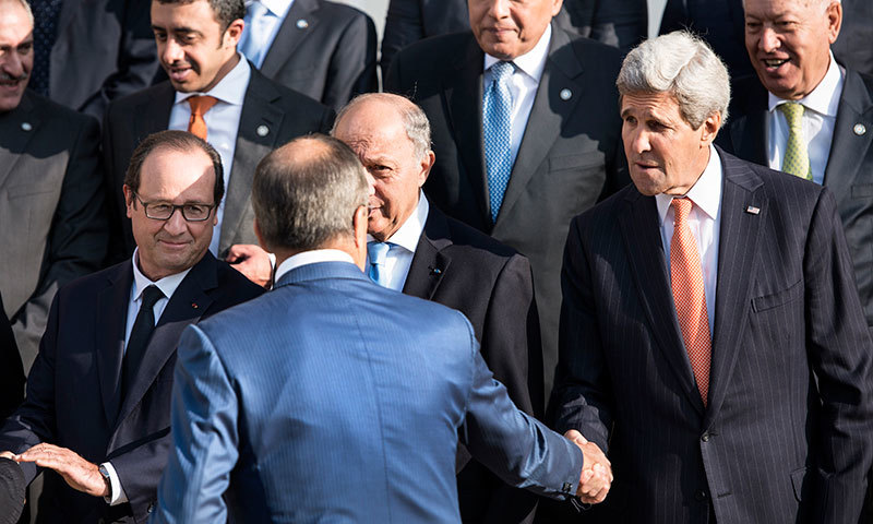 French President Francois Hollande, left, watches US Secretary of State John Kerry, right, shaking hands with Russian Foreign Minister Sergey Lavrov in Paris, Monday, Sept 15, 2014. – AP Photo