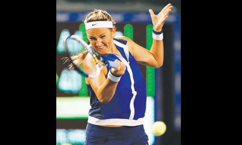 TOKYO: Victoria Azarenka of Belarus returns a shot to Japan's Kimiko Date-Krumm during their match at the Pan Pacific Open on Tuesday.—Reuters