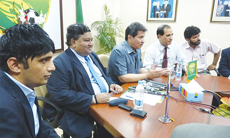 FIFA's former Development Officer Vernon Manilal Fernando (second L) sits next to PFF president Faisal Saleh Hayat during a press conference on his visit to Pakistan in April 2010.—PFF/File