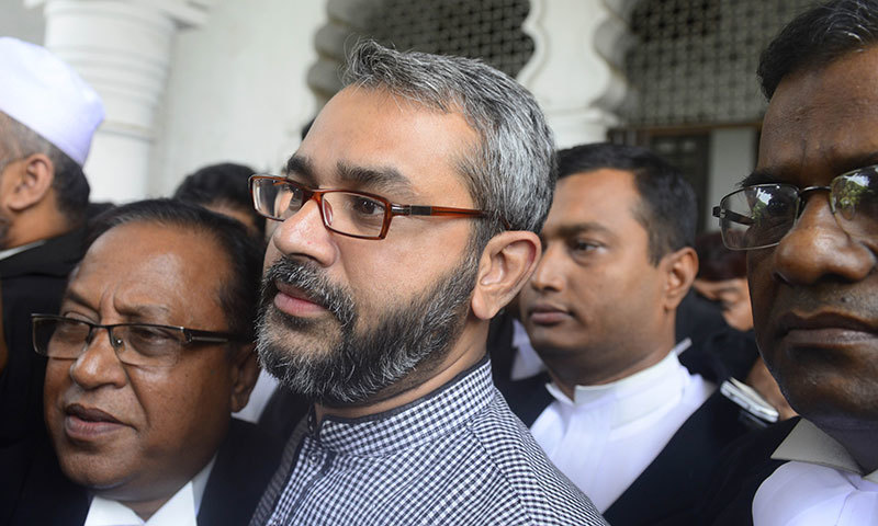 Bangladeshi son of Jamaat-e-Islami leader Delwar Hossain Sayedee, Masud Bin Sayedee, leaves court after Delwar Hossain Sayedee's death sentence was commuted in Dhaka on September 17, 2014. — Photo by AFP