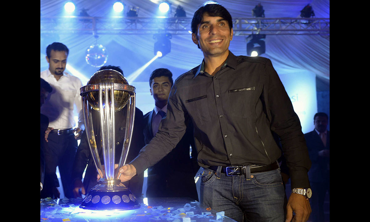 Pakistani cricket team skipper Misbah-ul-Haq poses with ICC World Cup 2015 trophy during a ceremony in Lahore. — Photo by AFP