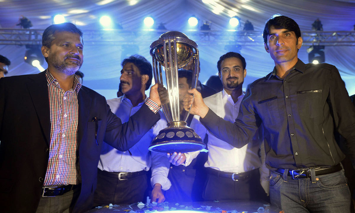 Pakistani cricket team skipper Misbah-ul-Haq (R) and team manager Moin Khan (L) hold the ICC World Cup 2015 trophy during a ceremony in Lahore. — Photo by AFP