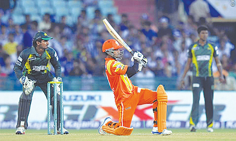 RAIPUR: Lahore Lions captain Mohammad Hafeez watches the ball after playing a lofty shot as Southern Express wicket-keeper Kusal Perera looks on during their Champions League T20 qualifier on Tuesday.—Photo courtesy BCCI
