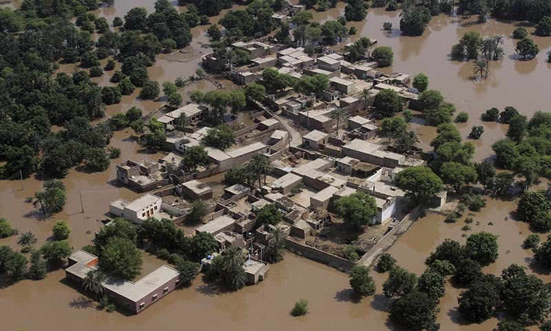 An aerial view shows houses surrounded by flood waters in Multan district, on Sunday, Sept. 14, 2014. — Photo by AP