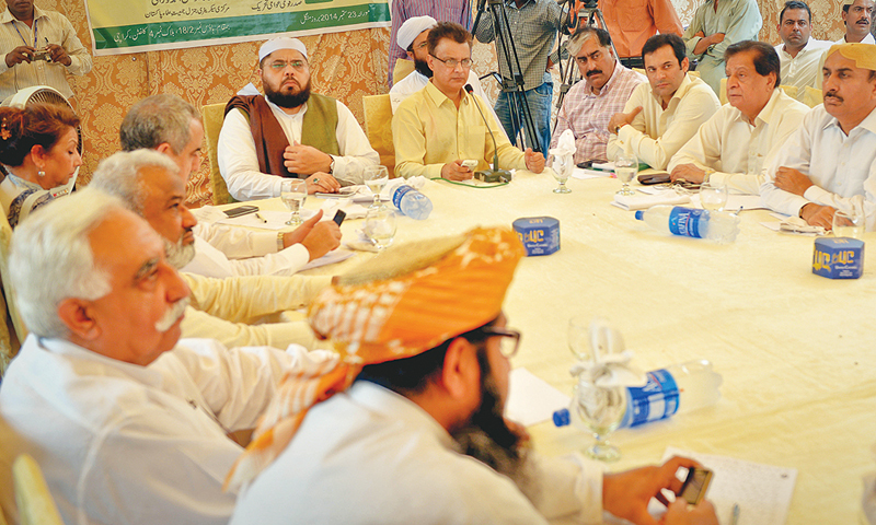 MAULANA Owais Ahmad Noorani, secretary general of the Jamiat Ulema-i-Pakistan, presides over a multi-party conference on Tuesday. —White Star