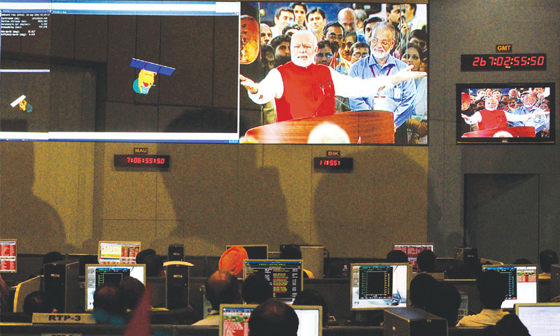 BANGALORE: Scientists and engineers of the Indian Space Research Organisation watch Prime Minister Narendra Modi on the screen after their spacecraft entered the orbit of Mars on Wednesday.—Reuters