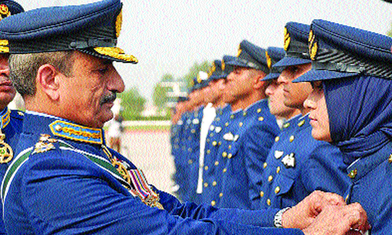 Chief of Air Staff Air Chief Marshal Tahir Rafique Butt applying badges to cadets during the graduation ceremony at PAF Academy Risalpur on Wednesday. — Online