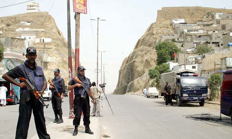 Police commandos patrol Karachi's violent Kati Pahari (Split Mountain) area. One side of the hill is populated by Mohajirs and the other by Pakhtuns.