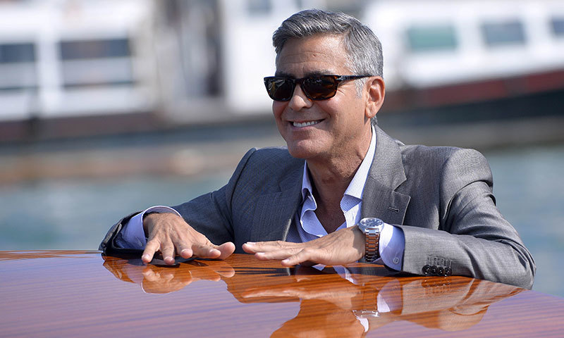 US actor George Clooney takes a taxiboat upon his arrival in Venice, on the eve of his wedding. -Photo by AFP